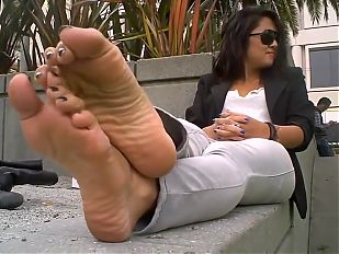 Beautiful woman shows her hot feet !!