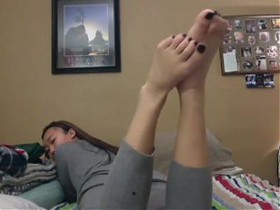 long haired teen shows feet