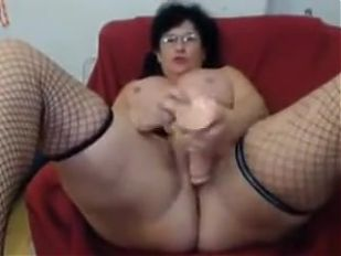 Sexy Italian granny fists her old pussy on cam