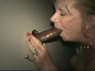A mommy fucks bare black in the gloryhole