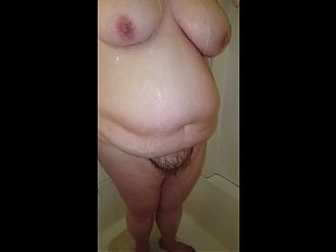 showering her big breasts & bush